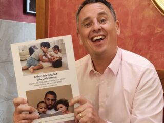 Fathers mental health campaigner Mark Williams with a copy of his 10 year gathering report